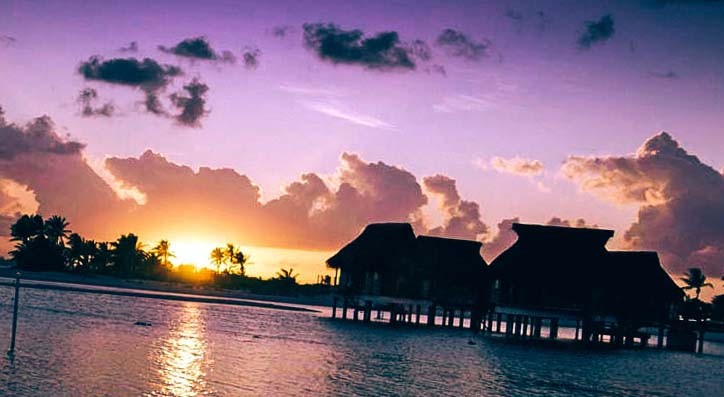 water bungalows in the rays of sunset